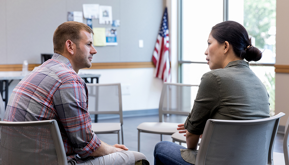 Veteran consulting with mental health professional